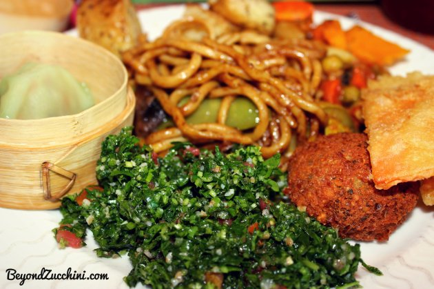 Vegan Brunch items from Al Bustan Rotana: Tabbouli, falafel, vegetarian dimsum, veggie yaki soba, and some roasted root vegetable salad.